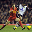 Liverpool's Jordan Henderson left, tackles Norwich City's Leroy Fer for the ball during their English Premier League soccer match at Anfield in Liverpool, England, Wednesday Dec 4, 2013