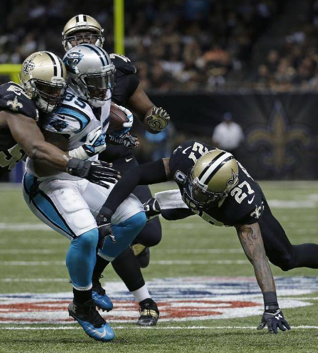 Carolina Panthers fullback Mike Tolbert (35) is tackled by New Orleans Saints middle linebacker Curtis Lofton (50) and free safety Malcolm Jenkins (27) in the second half of an NFL football game in New Orleans, Sunday, Dec. 8, 2013. The Sainst won 31-13