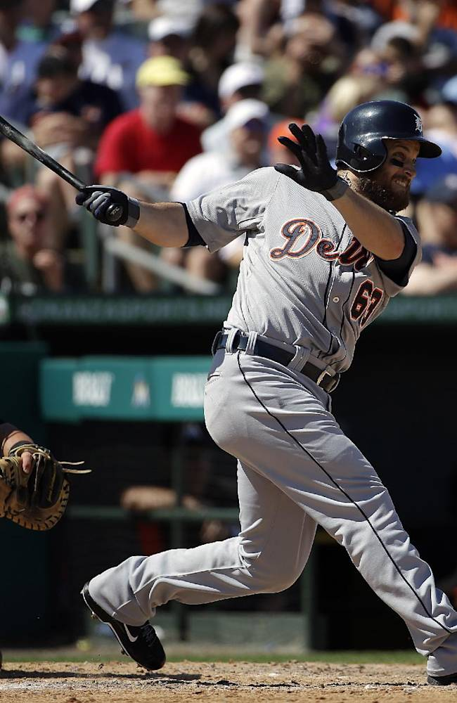 Detroit Tigers' Trevor Crowe hits a single in the sixth inning of an exhibition spring training baseball game against the Miami Marlins, Sunday, March 9, 2014, in Jupiter, Fla