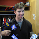 New York Giants quarterback Eli Manning speaks to the media Monday, Dec. 30, 2013, in East Rutherford, N.J. after the Giants season ended with a 7-9 record The Associated Press