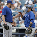 Toronto Blue Jays catcher Dioner Navarro, right, congratulates starting pitcher Mark Buehrle, left, as Buehrle leaves a spring exhibition baseball game against the New York Yankees in the seventh inning in Tampa, Fla., Sunday, March 23, 2014 The Associate