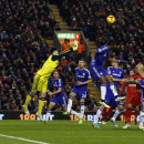 Liverpool's Martin Skrtel, second right, attempts to score during the English League Cup semi-final first leg soccer match between Liverpool and Chelsea at Anfield Stadium, Liverpool, England, Tuesday Jan. 20, 2015