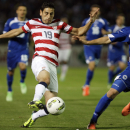 Bosnia's Ervin Zukanovic, right, is challenged by Alejandro Bedoya of USA during their friendly soccer match in Sarajevo, Bosnia, on Wednesday, Aug. 14, 2013. (AP Photo/Amel Emric)