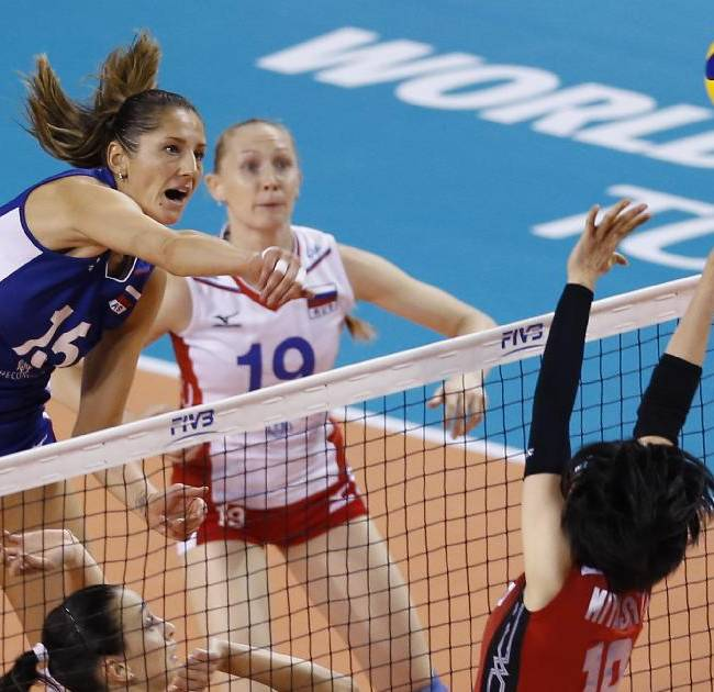 Russia's Tatiana Kosheleva, left, spikes the ball against Japan's Haruka Miyashita during their final round match of the Women's Volleyball World Grand Prix in Tokyo, Wednesday, Aug. 20, 2014
