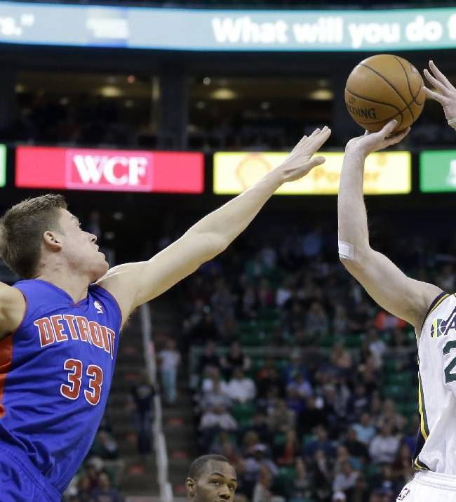 Utah Jazz's Gordon Hayward (20) shoots as Detroit Pistons' Jonas Jerebko (33) defends in the second half during an NBA basketball game Monday, March 24, 2014, in Salt Lake City. The Pistons won 114-94