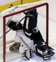 Anaheim Ducks goalie Jonas Hiller falls into the net after Chicago Blackhawks' Bryan Bickell scored during the third period of an NHL hockey game in Chicago, Friday, Jan. 17, 2014. The Blackhawks won 4-2. (AP Photo/Nam Y. Huh)