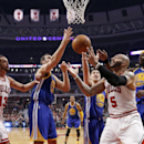 Chicago Bulls forward Carlos Boozer (5) battles Golden State Warriors center Andrew Bogut (12), Klay Thompson (11) and Jermaine O'Neal (7) for a rebound as Joakim Noah (13) watches during the first half of an NBA basketball game, Wednesday, Feb. 26, 2014,