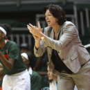 FILE - In this Feb. 13, 2014, file photo, Miami coach Katie Meier yells instructions to her team during the first half of an NCAA college basketball game against Maryland in Coral Gables, Fla. Meier is now under contract to lead Miami's women's basketball program through 2021, with an extension being announced Monday, Oct. 13, 2014, by the school. Financial terms of the deal were not released. Meier, however, revealed that she donated $75,000 to support women's sports at the school, a pledge that has already gotten several longtime Hurricane supporters to follow suit. (AP Photo/J Pat Carter, File)