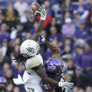 Baylor cornerback Joe Williams (22) breaks up a pass against TCU wide receiver Bailey Desormeaux (81) during the first half of an NCAA college football game Saturday, Nov. 30, 2013, in Fort Worth, Texas The Associated Press