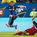 Chicago Fire's Matt Watson, right, slides in on Montreal Impact's Andres Romero during the second half of an MLS soccer game Saturday, Aug. 16, 2014, in Montreal The Associated Press