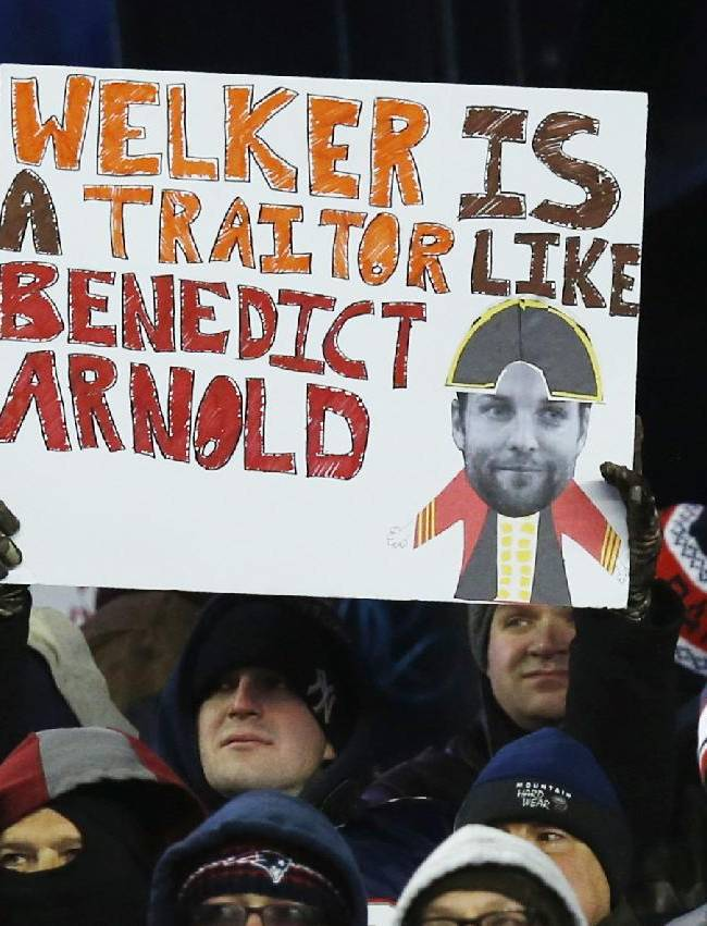 A New England Patriots fan holds a sign about Denver Broncos wide receiver Wes Welker, formerly with the Patriots, in the second quarter of an NFL football game Sunday, Nov. 24, 2013, in Foxborough, Mass