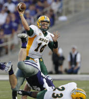 North Dakota State quarterback Brock Jensen (16) passes behind the block of running back John Crockett (23) on Kansas State defensive end Ryan Mueller (44) during the first half of an NCAA college football game in Manhattan, Kan., Friday, Aug. 30, 2013. (AP Photo/Orlin Wagner)