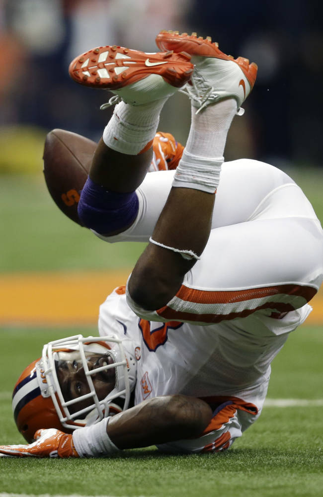 Clemson cornerback Darius Robinson (8) makes an interception against Syracuse during the second half of an NCAA college football game on Saturday, Oct. 5, 2013, in Syracuse, N.Y. Clemson won, 49-14