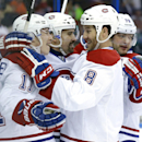 Montreal Canadiens center Tomas Plekanec, second from left, of the Czech Republic, celebrates with teammates, including Brendan Gallagher, left, Brandon Prust, second from right, and Andrei Markov, right, after scoring against the Tampa Bay Lightning dur