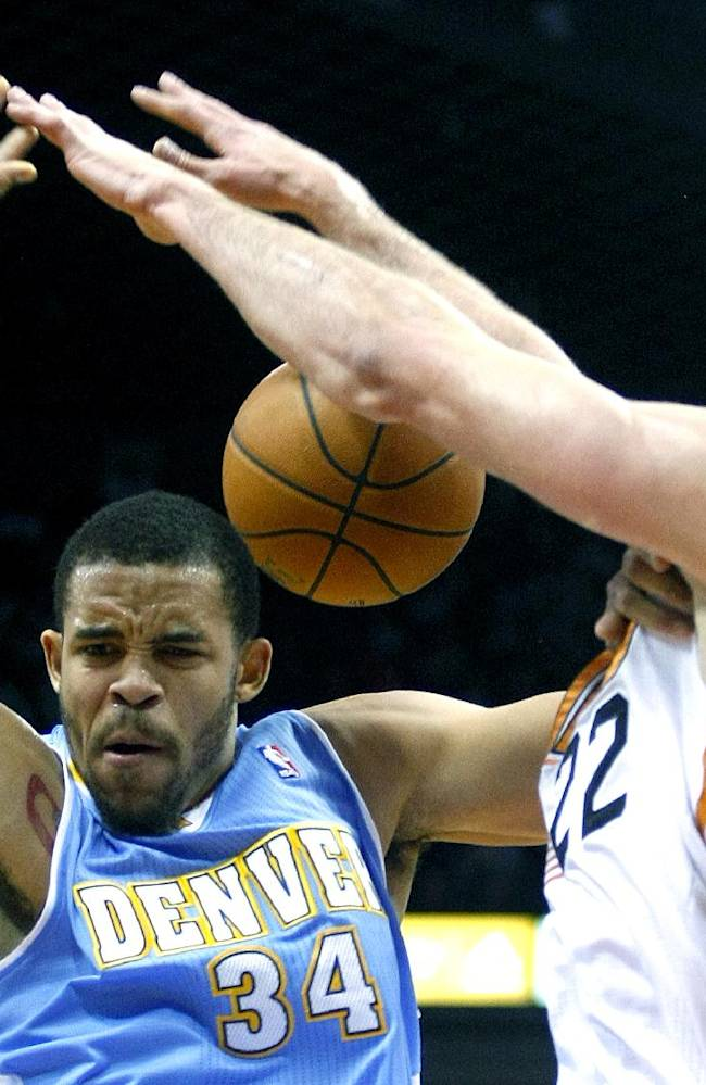 Denver Nuggets center JaVale McGee (34), left, is fouled by Phoenix Suns center Miles Plumlee (22) in the first quarter during an NBA basketball game on Friday, Nov. 8, 2013, in Phoenix