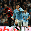 Manchester City's David Silva, left, battles with West Bromwich Albion's Youssuf Mulumbu during the English Premier League soccer match at the Etihad Stadium, Manchester, England, Monday April 21, 2014