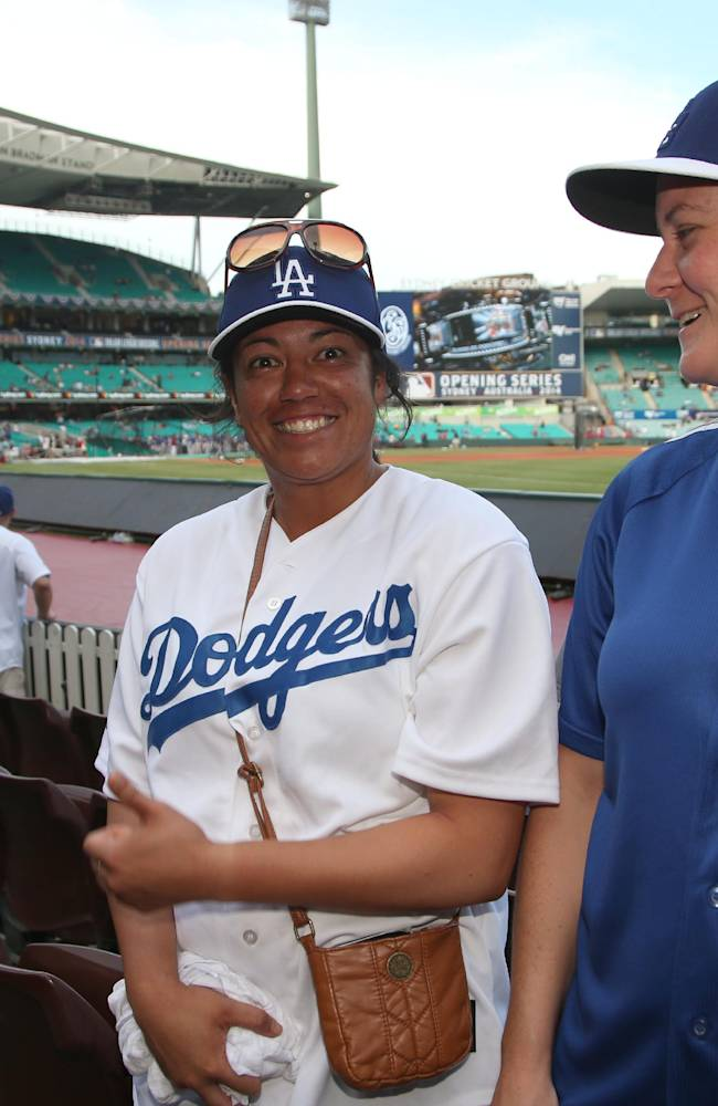 Narelle Walton, right, and her fridend Mereana Joseph arrive at the Sydney Cricket Ground where the Major League Baseball opening game between the Los Angeles Dodgers and Arizona Diamondbacks is scheduled in Sydney, Saturday, March 22, 2014