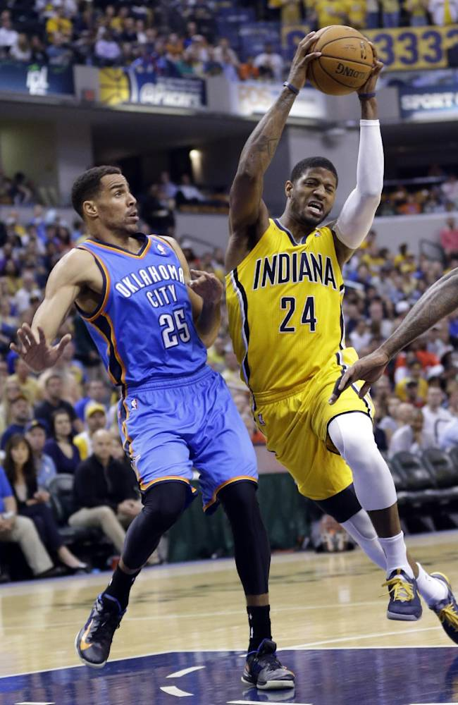 Indiana Pacers forward Paul George (24) cuts in front of Oklahoma City Thunder guard Thabo Sefolosha as he drives the lane in the second half of an NBA basketball game in Indianapolis, Sunday, April 13, 2014. The Pacers defeated the Thunder 102-97