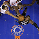 Orlando Magic's Glen Davis, right, goes up for a rebound against Philadelphia 76ers' Lavoy Allen, center, and Michael Carter-Williams during the second half of an NBA basketball game, Tuesday, Dec. 3, 2013, in Philadelphia The Associated Press