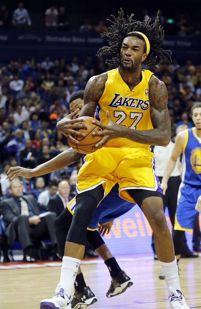 Jordan Hill of Los Angeles Lakers, front, dives against Kent Bazemore of Golden State Warriors, back, during a 2013-2014 NBA preseason game between Lakers and Warriors at Mercedes-Benz Arena in  Shanghai, China, Friday, Oct. 18, 2013