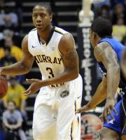 Murray State's Isaiah Canaan (3) dribbles under pressure from Tennessee State's Patrick Miller in the first half of an NCAA college basketball game on Thursday, Feb. 9, 2012, in Murray, Ky. (AP Photo/Stephen Lance Dennee)