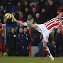 Stoke City's Peter Crouch stretches to reach the ball during their English Premier League soccer match against Crystal Palace at Selhurst Park, London, Saturday Dec. 13, 2014