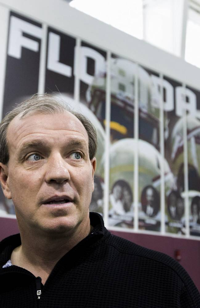 Florida State coach Jimbo Fisher talks to attendees during pro day held for NFL football scouts, Tuesday, March 18, 2014, in Tallahassee, Fla