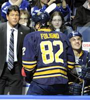 Buffalo Sabres head coach Ted Nolan, left, takes his place behind the bench before an NHL hockey game against the Toronto Maple Leafs in Buffalo, N.Y., Friday, Nov. 15, 2013. (AP Photo/Gary Wiepert)