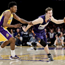 Los Angeles Lakers forward Nick Young, left, fouls Phoenix Suns guard Goran Dragic during the second half of an NBA basketball game in Los Angeles, Tuesday, Dec. 10, 2013 The Associated Press