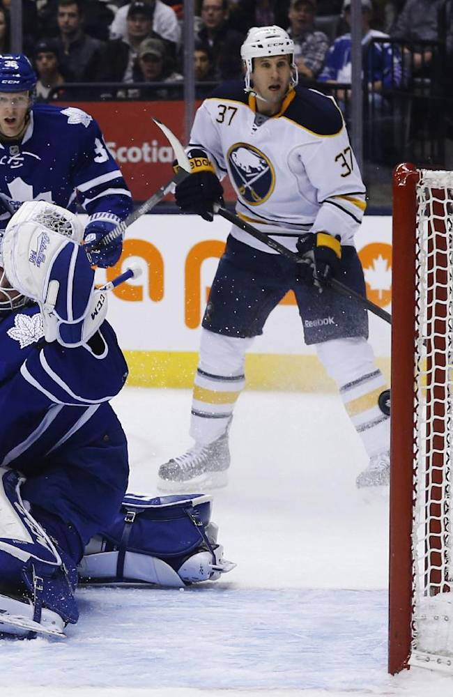 Toronto Maple Leafs goalie Jonathan Bernier lets in a goal by Buffalo Sabres' John Scott, not seen, during the first period of an NHL hockey game Friday, Dec. 27, 2013, in Toronto