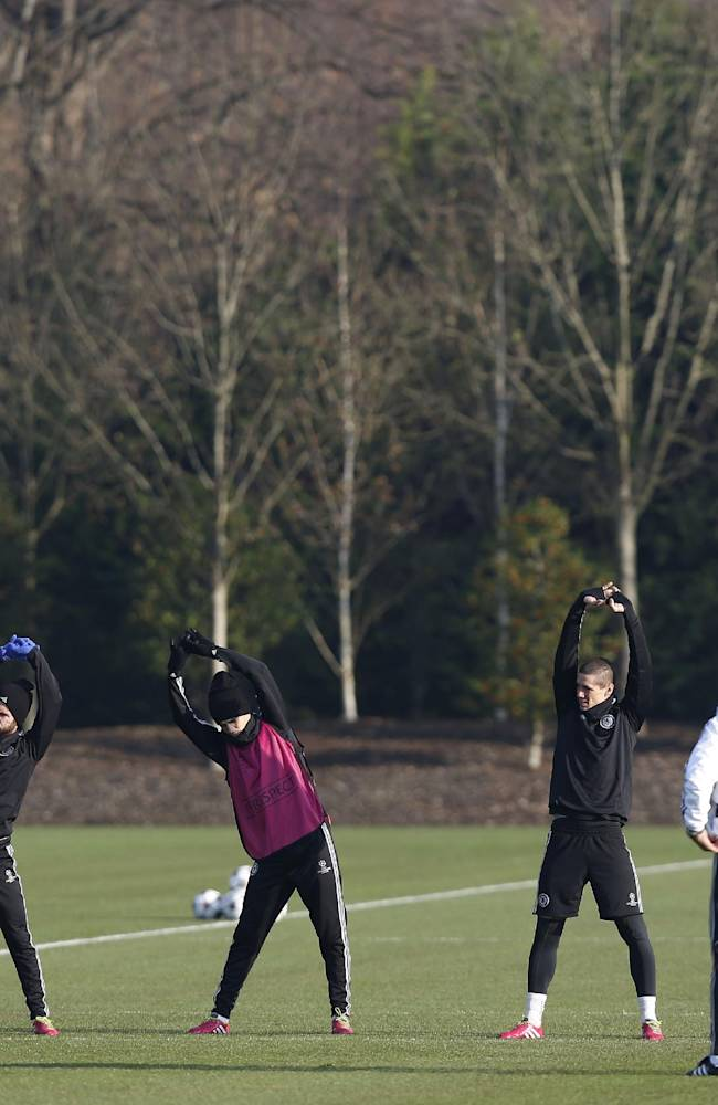Chelsea's, from left, John Terry, Juan Mata, Oscar, Fernando Torres and Gary Cahill warm up during a training session at Cobham training ground in Cobham, England, Tuesday, Dec. 10, 2013. Chelsea will play Steaua Bucharest in the Champions League group E soccer match at Stamford Bridge stadium on Wednesday, Dec. 11