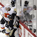 Calgary Flames' Ladislav Smid (15) collides with Pittsburgh Penguins' Patric Hornqvist (72) along the boards during the first period of an NHL hockey game in Pittsburgh Friday, Dec. 12, 2014 The Associated Press