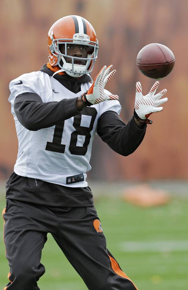 Cleveland Browns wide receiver Greg Little catches a pass during practice at the NFL football team's facility in Berea, Ohio Wednesday, Nov. 6, 2013