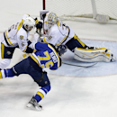 Nashville Predators goalie Carter Hutton makes a save on a shot by St. Louis Blues' Ryan Reaves (75) as Predators' Shea Weber (6) watches during the first period of an NHL hockey game Thursday, Jan. 29, 2015, in St. Louis The Associated Press