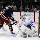 Toronto Maple Leafs goalie Jonathan Bernier (45) stops a shot by New York Rangers' Dan Girardi (5) during the second period of an NHL hockey game Wednesday, March 5, 2014, in New York The Associated Press