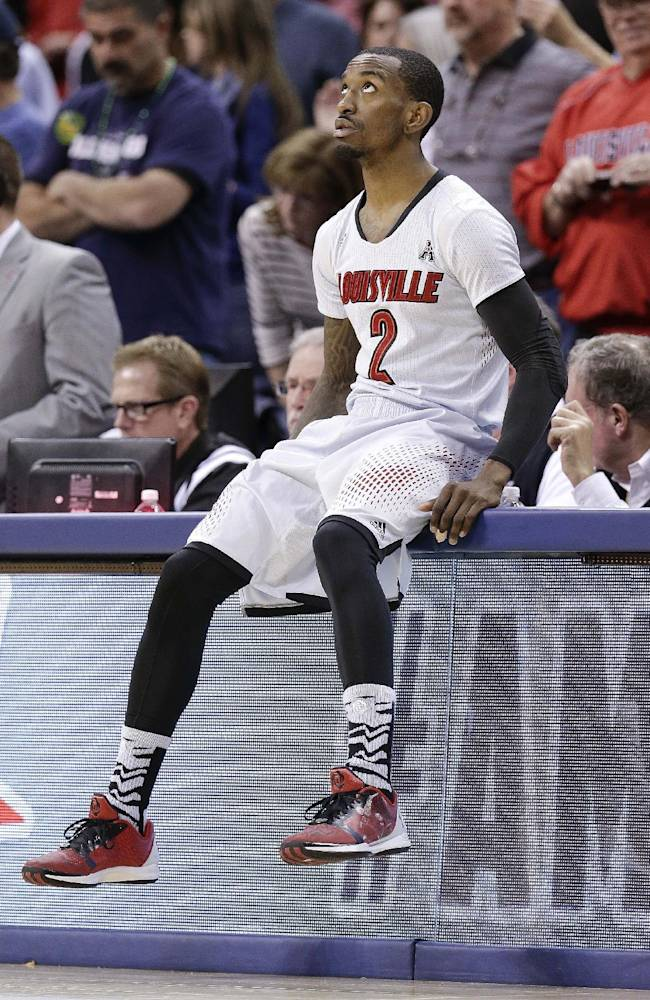 Louisville guard Russ Smith looks at the scoreboard as he waits for an NCAA college basketball game against Connecticut to get underway, in the finals of the American Athletic Conference men's tournament Saturday, March 15, 2014, in Memphis, Tenn
