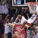 Miami Heat's Ray Allen hangs on to the rim after a dunk during the second half of an NBA basketball game against the Memphis Grizzlies in Miami, Friday, March 21, 2014. The Heat won 91-86 The Associated Press