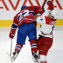 Montreal Canadiens right wing Dale Weise (22) runs into Carolina Hurricanes center Elias Lindholm (16) during the second period of an NHL hockey game Tuesday, Dec. 16, 2014, in Montreal The Associated Press