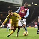 Aston Villa's Christian Benteke, right, battles for the ball with West Bromwich Albion's Ben Foster during the English Premier League soccer match at the Hawthorns, West Bromwich, England, Saturday Dec. 13, 2014. (AP Photo / Martin Rickett,PA)