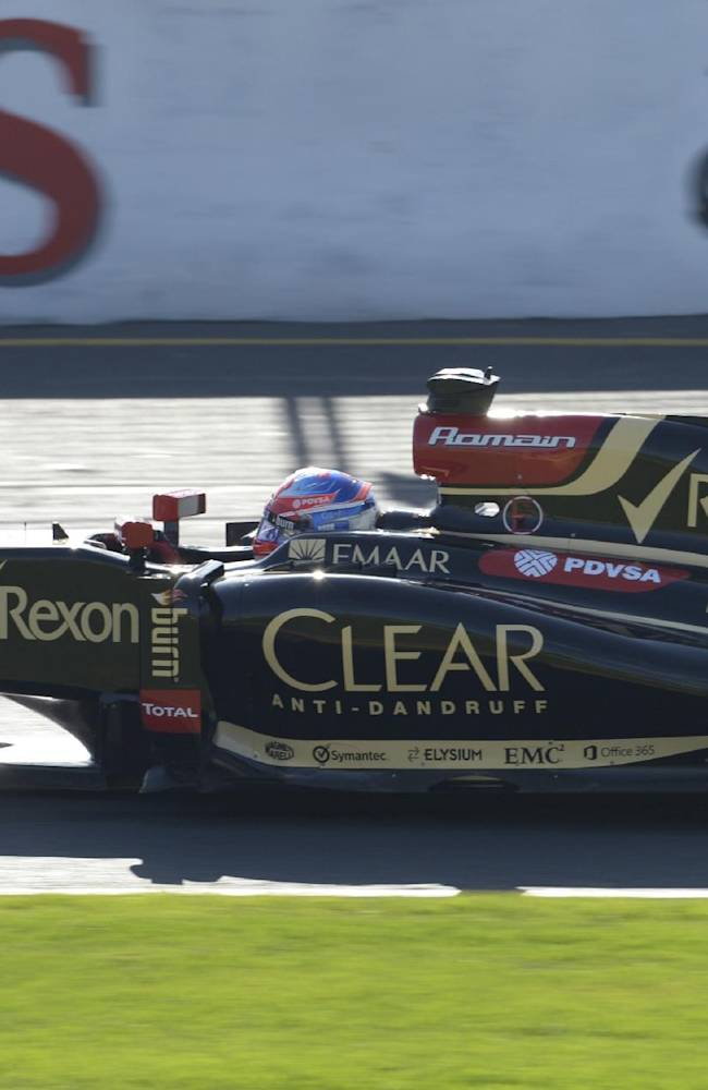Lotus driver Romain Grosjean of France controls his car on turn nine during the second practice session at Albert Park ahead of the Australian Formula One Grand Prix  in Melbourne, Australia, Friday, March 14, 2014