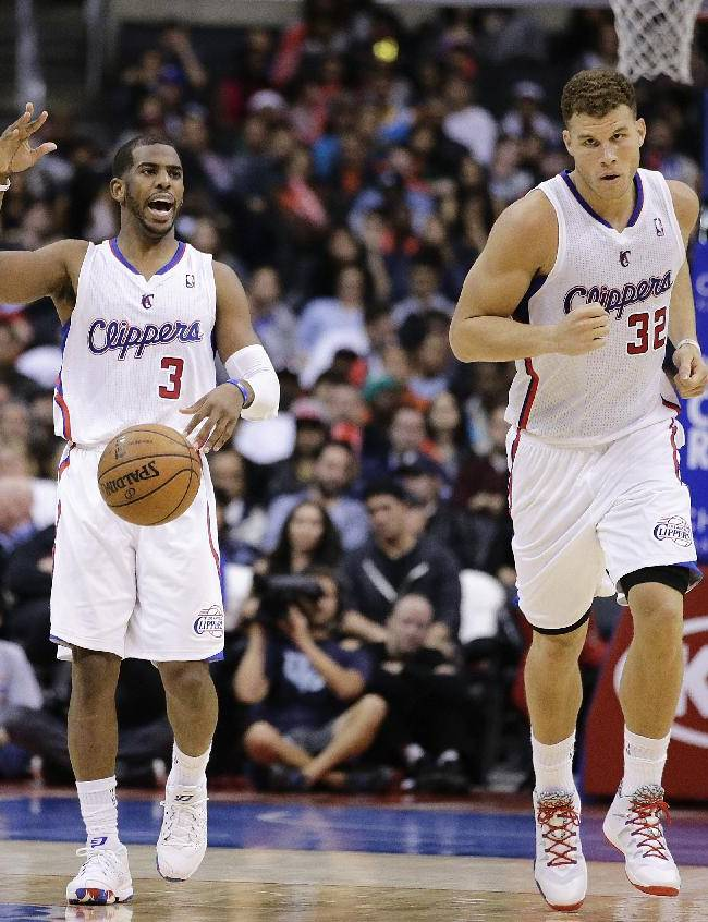 Los Angeles Clippers' Chris Paul, left, and Los Angeles Clippers' Blake Griffin make their way down the court during the second half of an NBA basketball game against the New Orleans Pelicans on Wednesday, Dec. 18, 2013, in Los Angeles. The Clippers won 108-95