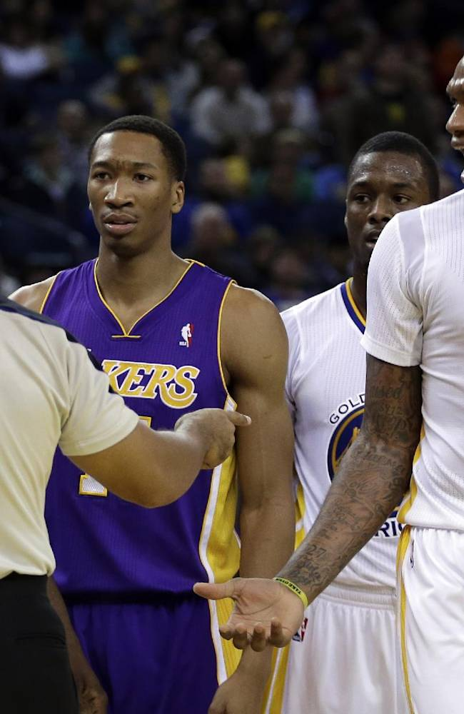 Golden State Warriors' Marreese Speights, right, reacts as he is called for a flagrant-2 foul during the second half of an NBA basketball game against the Los Angeles Lakers, Saturday, Dec. 21, 2013, in Oakland, Calif