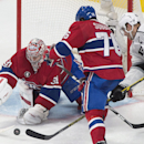 Montreal Canadiens goaltender Carey Price makes a save against Los Angeles Kings' Dustin Brown (23) as Canadiens' P.K. Subban defends during the third period of an NHL hockey game, Friday, Dec. 12, 2014 in Montreal The Associated Press