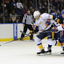 New York Islanders' Matt Carkner (7) and Aaron Ness, back, scuffle with Nashville Predators' Viktor Stalberg (25) for control of the puck in the third period of an NHL hockey game on Tuesday, Nov. 12, 2013, in Uniondale, N.Y. The Islanders won 3-1 The Ass