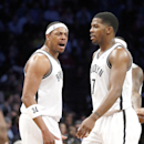 Brooklyn Nets forward Paul Pierce (34) shouts to teammate Joe Johnson (7) after he scored in the first half of an NBA basketball game against the Memphis Grizzlies on Wednesday, March 5, 2014, in New York The Associated Press