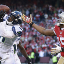 Seattle Seahawks cornerback Byron Maxwell, left, intercepts a pass intended for San Francisco 49ers wide receiver Michael Crabtree, (15), in the second half of an NFL football game, Sunday, Dec. 8, 2013, in San Francisco The Associated Press