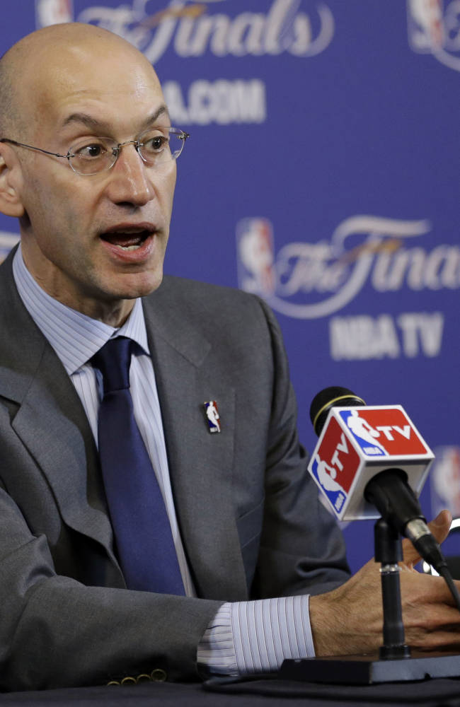 In this June 6, 2013,  file photo, Adam Silver speaks before the start of Game 1 of the NBA Finals basketball game between the San Antonio Spurs and Miami Heat, in Miami. Silver became the NBA's fifth commissioner on Feb. 1, 2014, responsible for continuing the growth the league saw under David Stern
