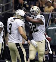 New Orleans Saints running back Mark Ingram (22) celebrates his touchdown reception with quarterback Drew Brees (9) in the first half of an NFL preseason football game against the Oakland Raiders at the Mercedes-Benz Superdome in New Orleans, Friday, Aug. 16, 2013. (AP Photo/Jonathan Bachman)