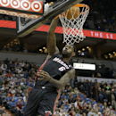 Miami Heat forward LeBron James (6) dunks the ball during the first quarter of an NBA basketball game against the Minnesota Timberwolves in Minneapolis, Saturday, Dec. 7, 2013. James had a game-high 21 points as the Heat won 103-82 The Associated Press