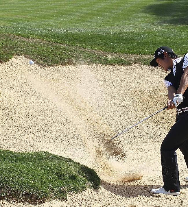 Danny Lee, of New Zealand, blasts out of a sand trap on the 18th hole during the first round of the Valero Texas Open golf tournament, Thursday, March 27, 2014, in San Antonio